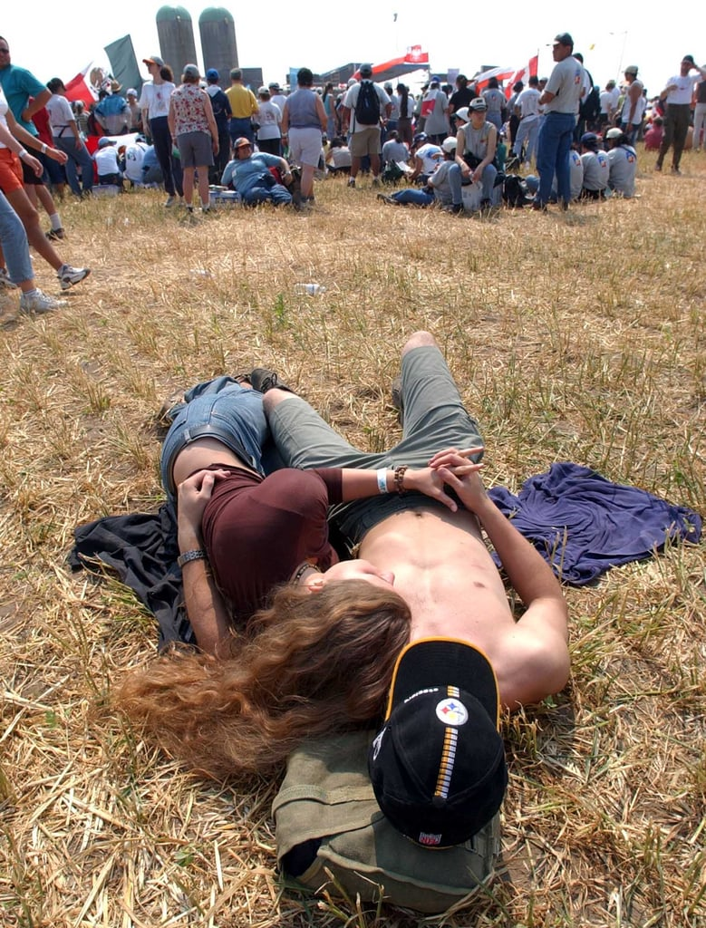 A couple laid down together at World Youth Day Community Festival in Southwestern Ontario.