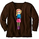 Perfect for back-to-school season, this chic sweater ($52) features a stylish tot on a chocolate brown background.