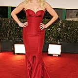 Reese Witherspoon in a red Zac Posen gown.