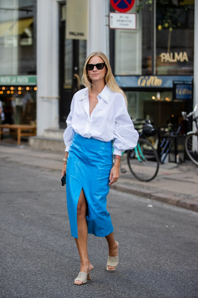 A crisp white puff-sleeve shirt works great with a solid-coloured midi skirt