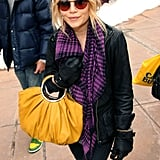 Mary-Kate wore an ombré pair with a plaid scarf and mustard ring bag in Utah in 2008.