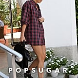 Miley Cyrus left her hotel in Miami wearing a long plaid shirt.