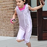 Suri Cruise looked cute in a purple dress.