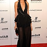 Joan Smalls married sexy with playful via peplum details and a deep neckline.