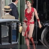 Isla Fisher wore a red wrap dress in Sydney.