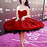 Every girl needs a dress she can twirl in. For the 2012 LA premiere of her documentary Katy Perry: Part of Me, Katy wowed in a red velvet Dolce & Gabbana full-skirt creation, matching pumps, and ombré purple curls.