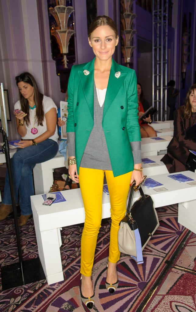 Olivia Palermo paired a green blazer with bright yellow pants to attend the Anya Hindmarch show during London Fashion Week.
