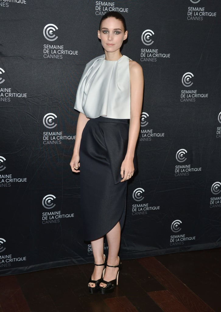 Rooney Mara donned a pale grey silk top and navy blue sculptural skirt, both by Dior, to the Ain't Them Bodies Saints premiere at Cannes. She added height with Brian Atwood platforms.