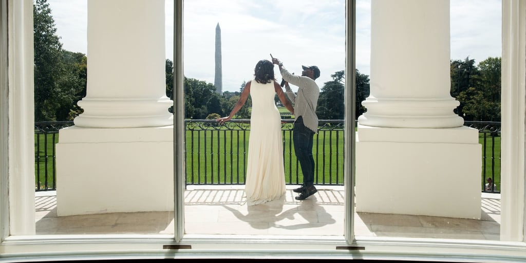 """Despite working with the most powerful family in the world, Wright says the actual glam room in the White House was surprisingly humble. """"You would think it would be this huge room with a vanity and all this stuff, but it wasn't,"""" he said. """"But the space was just a little room. It doubled as her second assistant's office in the residence, and it just happened to have a shampoo bowl in there, so that's where we did her hair. It's also the same place where the president would get his haircut. It was very simple."""" The Politics of Hair — and Where He Took Some Risks In a way, how you wear your hair is a form of storytelling. That's something Wright kept top of mind at all times: """"Hairstyling tells you a lot about a woman before she even says a word — it can tell you if she's sassy, conservative, sexy, or edgy, or all these things, just by the way she chooses to wear her hair. I understood how important that illustration of a story was, particularly for the first African American first lady of the United States."""" """"Hairstyling tells you a lot about a woman before she even says a word. I understood how important that illustration of a story was, particularly for the first African American first lady of the United States."""" There were moments throughout those eight years where he had to be especially mindful with Obama's hair, particularly when visiting other leaders from around the world. """"I did my due diligence to make sure she looked appropriate,"""" he said. """"Sometimes she wore a head covering, and other times I just wanted to make sure there was this sense of submission and respect in someone else's country. I remember when she met Queen Elizabeth, I pulled her hair back in a bun, so it was half-up and half-down, just to give it a little more innocence."""" That's not to say he didn't take risks — he did. """"In the grand scheme of things, I was able to switch up her hairstyle a lot in those eight years. I never did too much of a change, but you have to give some play room for B"""