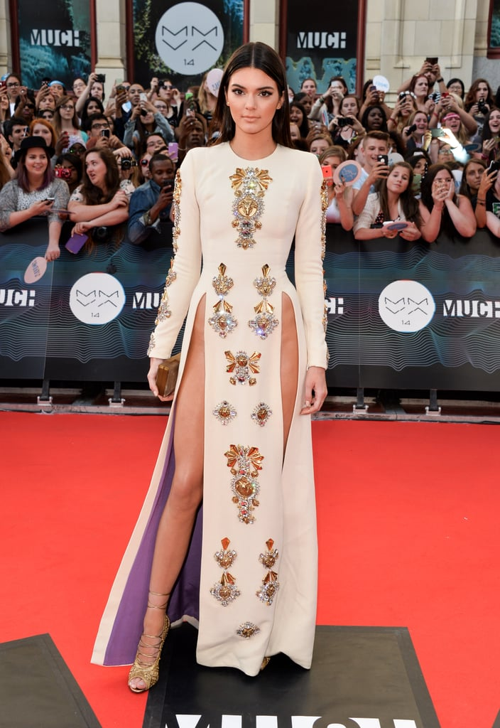 Kendall in a hip-high slit dress by Fausto Puglisi.