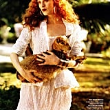 Karen Elson holding a — baby goat? Either way, it's adorable in Vogue.