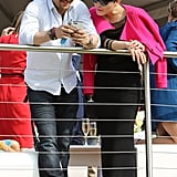 Checking out his phone with Noomi Rapace at the Audi Polo Challenge in 2016.