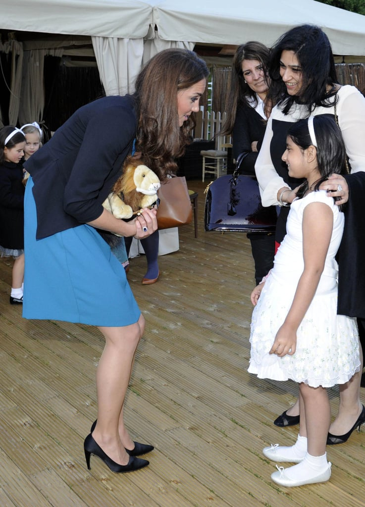 Kate Middleton wore a blue Zara dress.