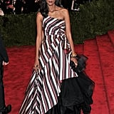 Liya Kebede rocked a striped Alberta Ferretti one-shouldered gown with a bevy of bracelets.