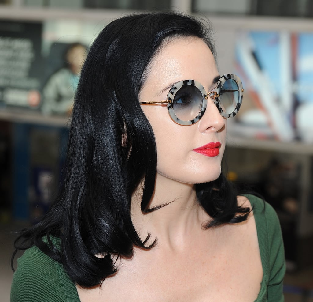 Dita Von Teese wore a pair of groovy round sunglasses.