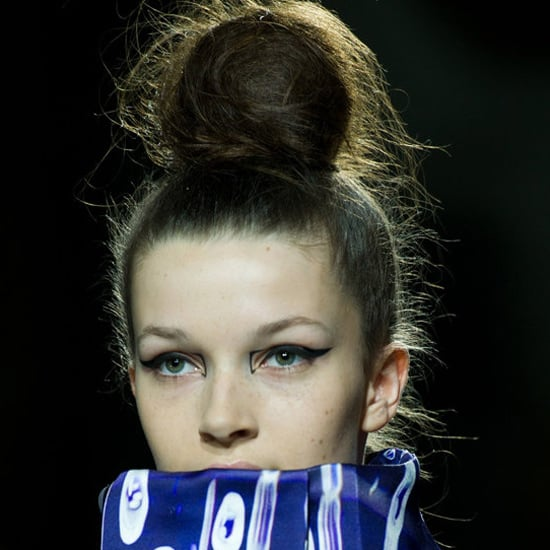 The bracket on the inner eye at Mary Katrantzou was also a creative update to the classic wing. Tip: when opting for a statement eye, keep everything else pared-back. A messy top knot is the perfect hairstyle to complement the look.