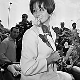 Legendary Italian actress Claudia Cardinale was greeted by fans as she arrived for a premiere in 1963.