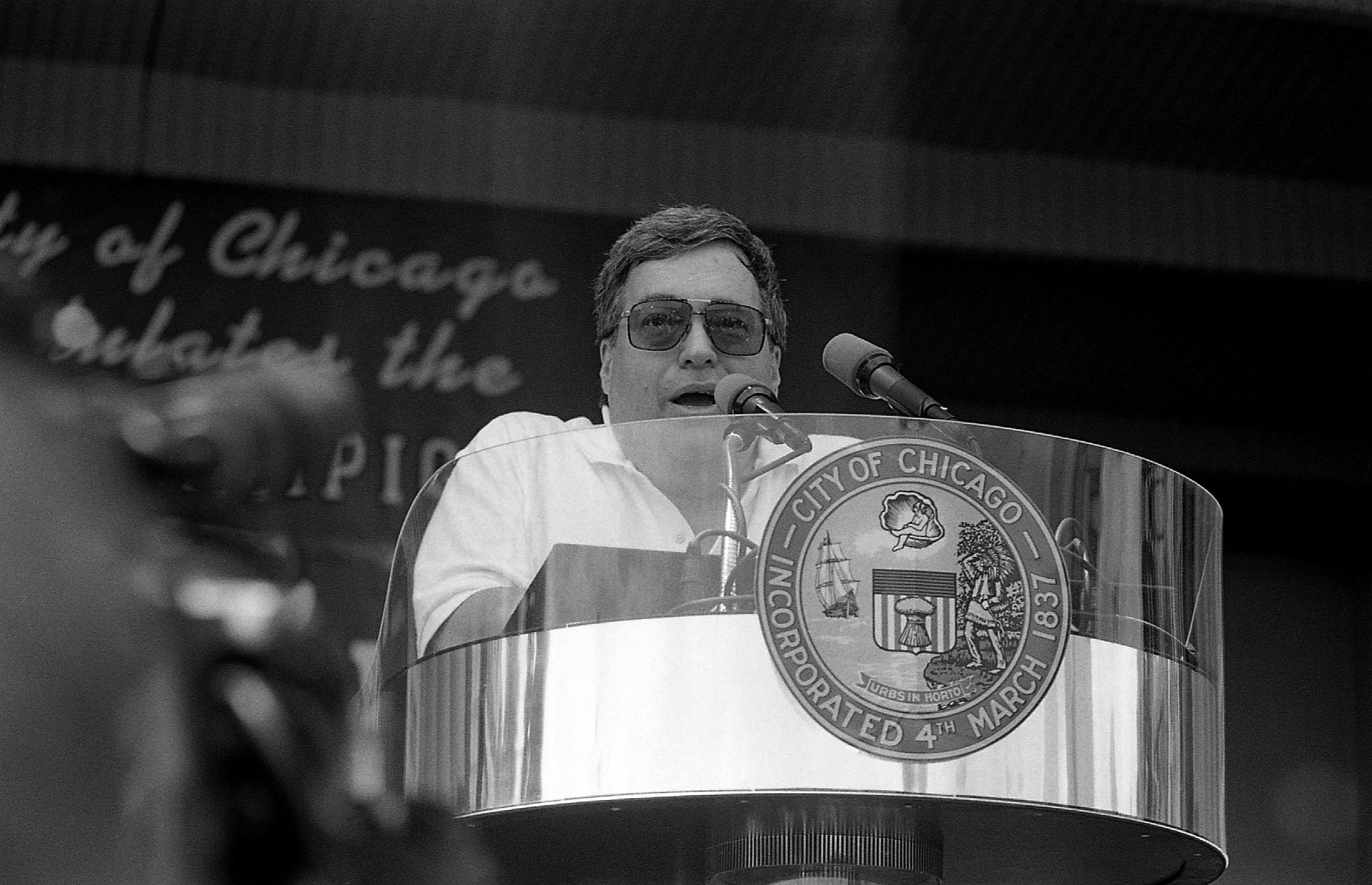 CHICAGO -  JUNE 1996:  Former Chicago Bulls General Manager Jerry Krause addresses the crowd during a celebration of the Chicago Bulls' 4th N.B.A. Championship at the Petrillo Music Shell in Chicago, Illinois in June1996.  (Photo By Raymond Boyd/Getty Images)