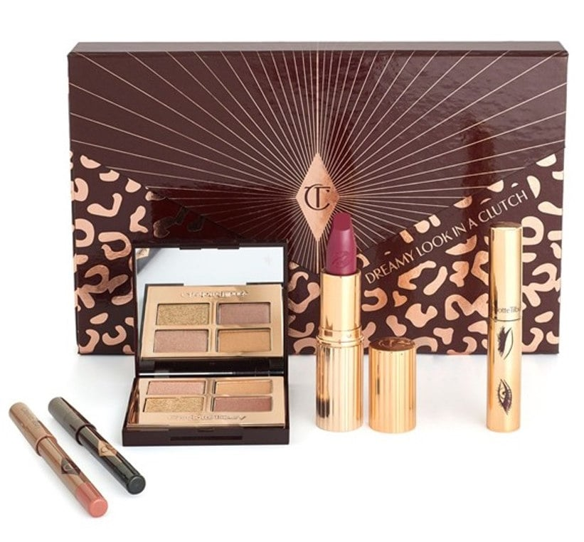 """Besides Charlotte Tilbury being an amazing woman, I am obsessed with everything she does! This super cute collection is something I'd gift anyone from my Bestie to my mom because this is a look that will suit anyone! I love the fact that each clutch comes with a lipstick shaped USB drive which fits into your computer and shows you how to create the Dreamy look!""    Charlotte Tilbury: Dreamy Look in a Clutch Collection	 ($128)"