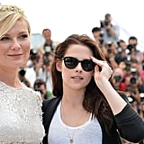 Kristen Stewart wore shades and posed with Kirsten Dunst at the On the Road photocall at the Cannes Film Festival.