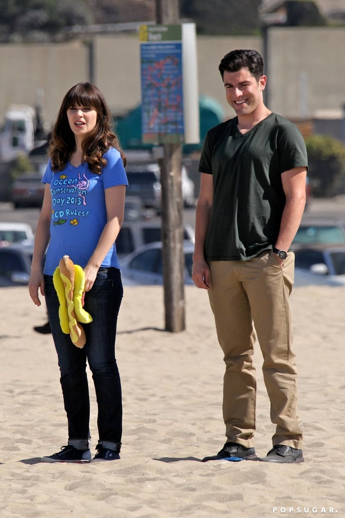 Max Greenfield and Zooey Deschanel filmed scenes on an LA beach.