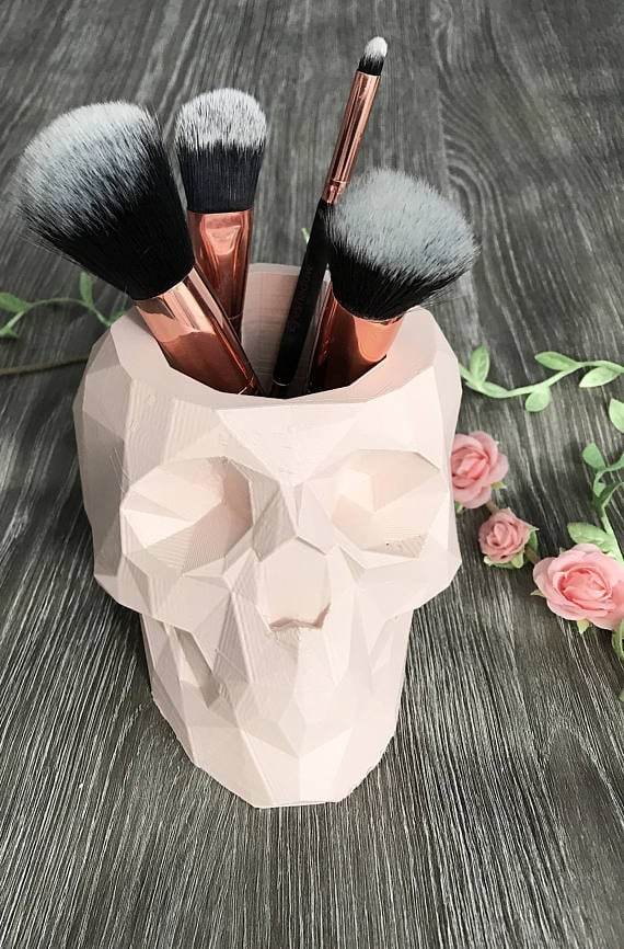 Ethereal Polygons Geometric Skull Brush Holder ($36)