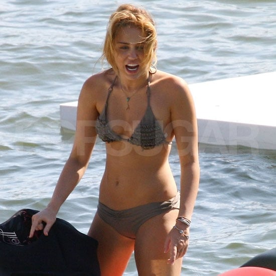 Miley Cyrus shows off her bikini body.