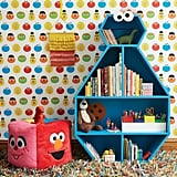 Cookie Monster Bookcase ($424, originally $499), Sesame Street Friends Fur Pouf ($129), Wall Decal ($49), and Big Bird Woven Wall Hanging ($20)