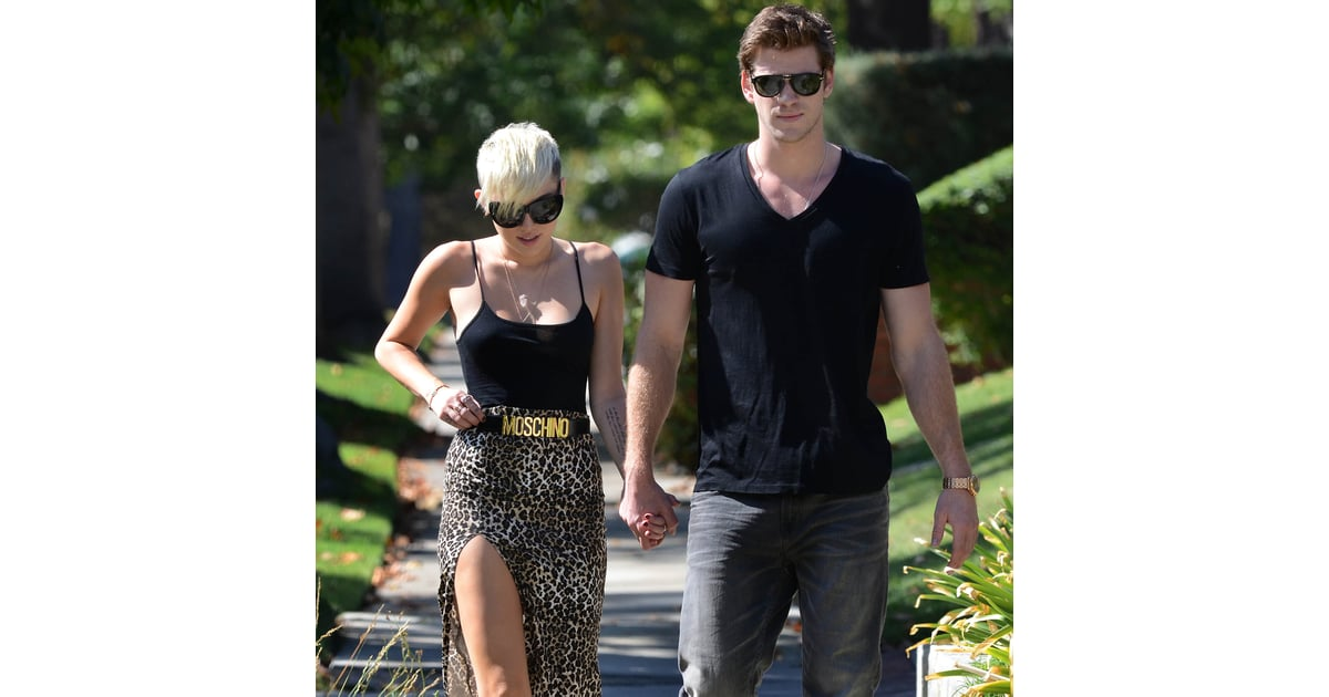 miley cyrus and liam hemsworth hold hands pictures