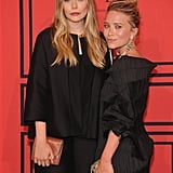Sisters Mary-Kate and Elizabeth Olsen both opted for bronzed makeup looks and blond-highlighted strands.