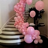 The Staircase Was Decked Out With Pink Balloons, Too