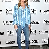 Nicky Hilton finished a pair of classic skinnies with pastel heels and a printed blouse.