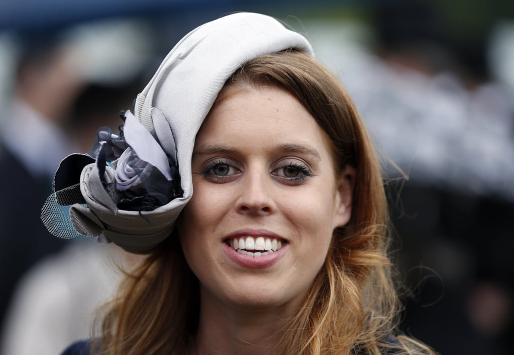 At a garden party in 2013, Princess Beatrice wore an asymmetrical lavender and plum headpiece.