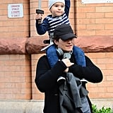 Orlando Bloom carried his little warrior around NYC on Friday.