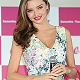 Miranda Kerr traveled to Japan for the Samantha Thavasa Ladies Tournament and sported pink polka-dot nail art along with a matching cerise lipstick.