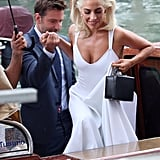 Bradley helped Gaga out of their water taxi as they arrived in style for the Venice Film Festival.