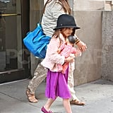 Suri Cruise in pink and purple.
