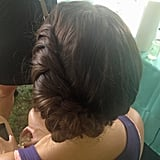 This updo was created at a braid bar on the festival grounds. It's a style that works for a music festival, but can also be transformed for a more formal event.