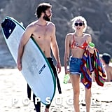 Miley Cyrus and Liam Hemsworth Hold Hands on the Beach After His Shirtless Surf Session