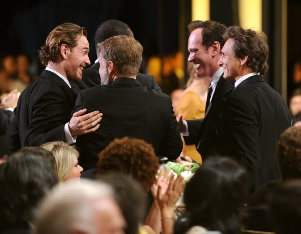 Michael Fassbender laughed it up with director Quentin Tarantino and producer Lawrence Bender at the SAG Awards in January 2010.