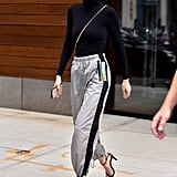 Fashion It-girls, like Gigi Hadid, have been spotted all over Fall Fashion Week rocking these athletic, stripe-down-the-side pants, and we can't get enough of it. By wearing a pair of these pants with a sleek turtleneck (and heels if you dare), it'll spice up the look and take it from workout ready to going-out appropriate instantly.