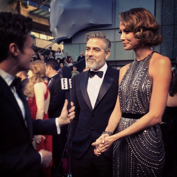 George Clooney and Stacy Keibler chatted with Ryan Seacrest. Source: Instagram user ryanseacrest