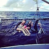 In August, Behati Pinsloo hit the ocean in a boat with a bud and a brew. Source: Instagram user behatiprinsloo