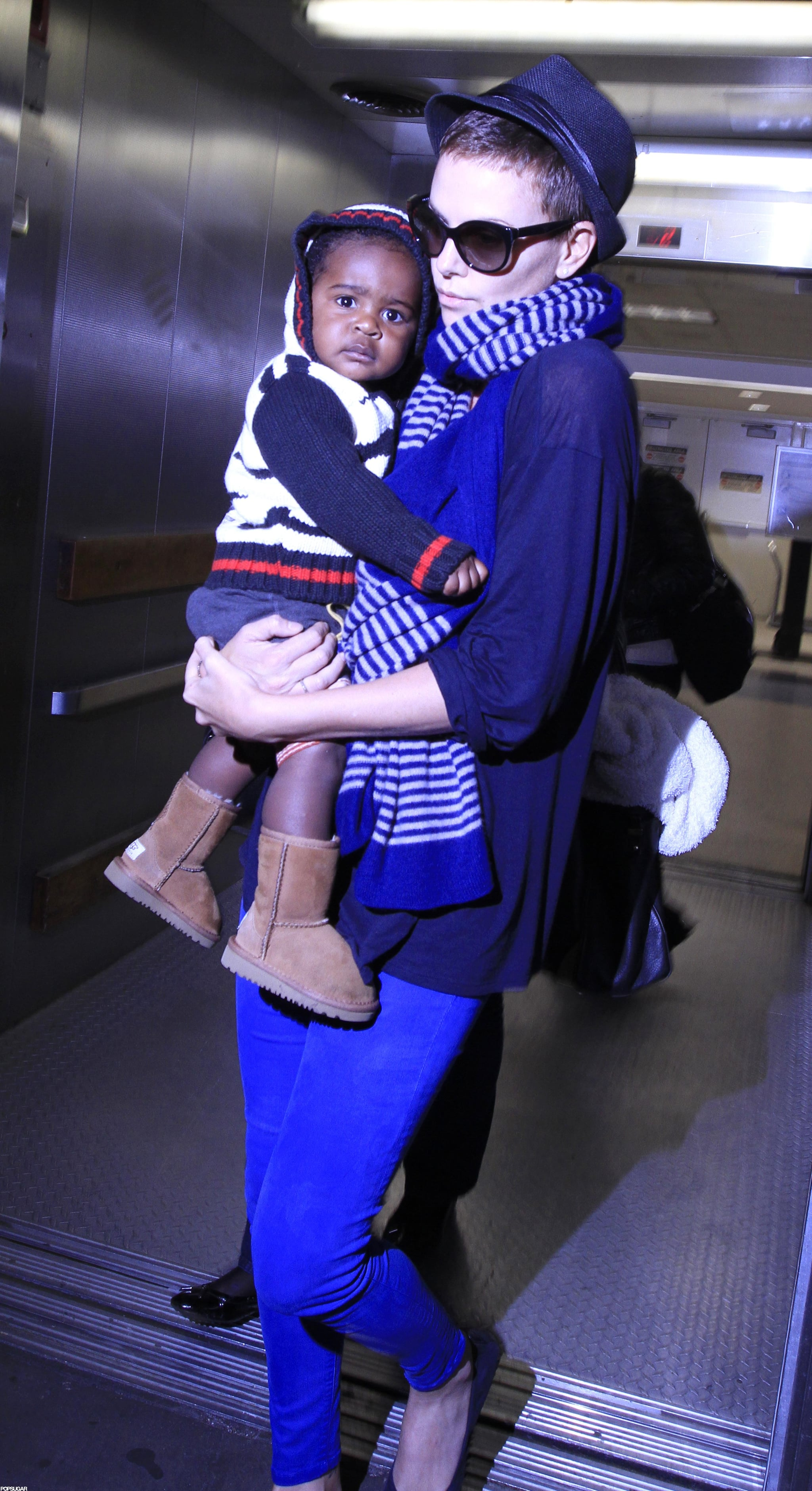Charlize Theron and Jackson Theron arrived in LA after a vacation.