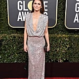 Keri Russell wearing a silver a Monique Lhuillier gown with Christian Louboutin heels.