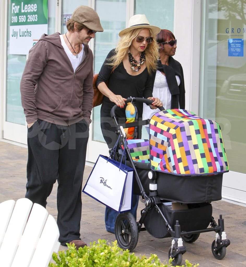Rachel Zoe and Rodger Berman carried a shopping bag from Ron Herman and doted on their son, Skyler Berman.