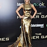 At the LA premiere of The Hunger Games, Jennifer Lawrence made an appearance in knock-out gold lamé cut-out gown from Prabal Gurung's Fall 2012 collection.