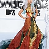 Lady Gaga honored the memory of her friend Alexander McQueen at the 2010 VMAs by arriving to the award show in a gown from the last collection he designed.