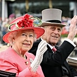 The royal pair waved during their Ladies Day carriage ride on June 16, 2011.
