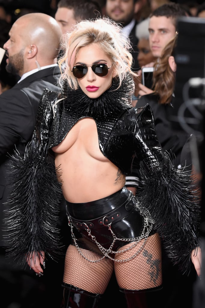 "Lady Gaga channeled her inner punk rocker when she attended the Grammys on Sunday night. Wearing a revealing black top, short shorts, tall leather boots, and newly pink hair, the ""Million Reasons"" singer looked too cool for school as she strutted her stuff on the red carpet. Not only did she pose alongside Metallica ahead of their performance tonight, but she even showed off her brand new moth tattoo that she got to celebrate the special occasion."